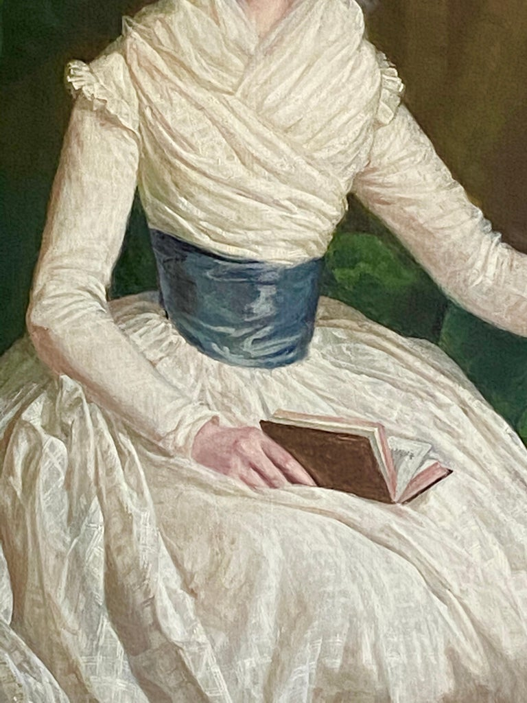 English 18th century Portrait of a Lady seated in a Library with a book - Black Interior Painting by Thomas Beach
