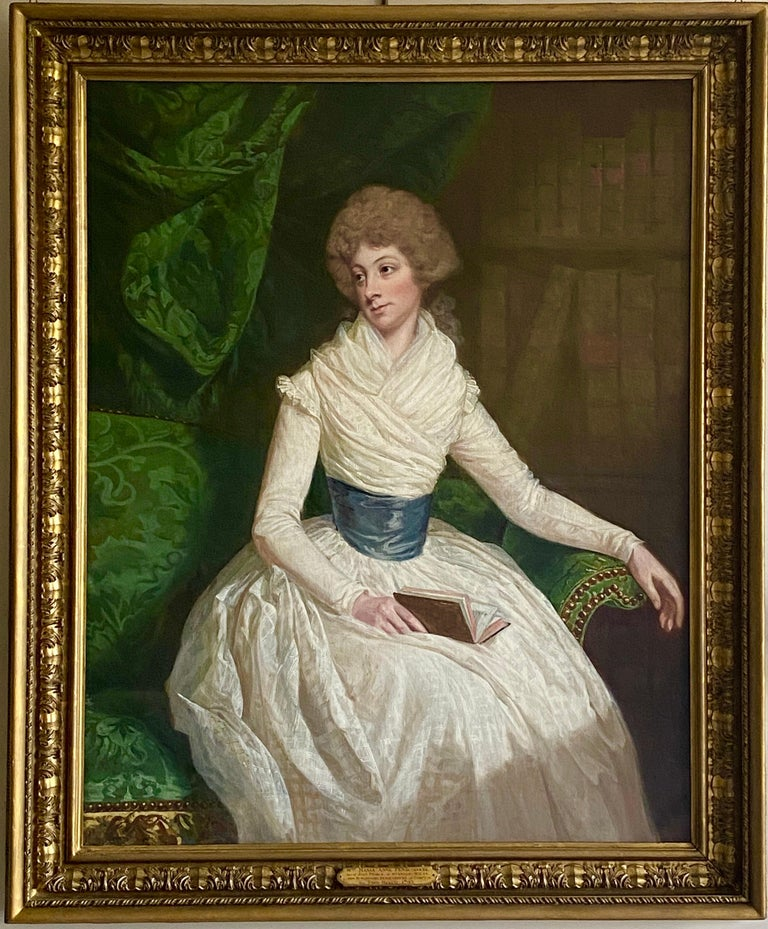Thomas Beach Interior Painting - English 18th century Portrait of a Lady seated in a Library with a book