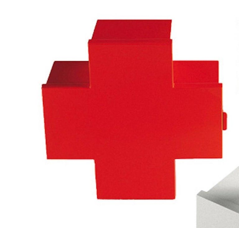 Designed to store medicine, the cross cabinet by Thomas Eriksson is wall-hanging, available with a glossy varnished finish, in red, orange, green, blue and white. Made of laser-cut and folded sheet metal, the doors of the cross cabinets fasten with