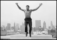 Muhammad Ali jumping from a bridge over the Chicago River