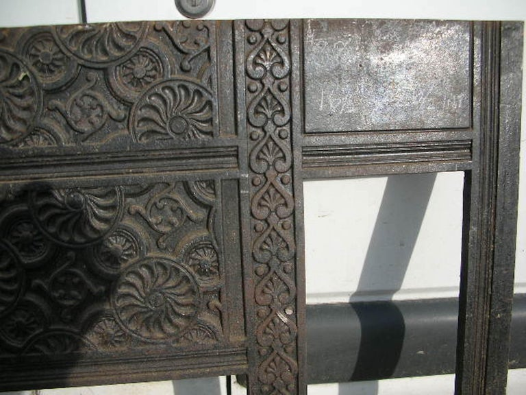 Thomas Jeckyll. An Aesthetic Movementcast iron fire insert with stylized flower details. Made by Barnard Bishop and Barnard of Norwich. This insert takes ten standard 6 inch square period tiles which fit easily from the back. Measures: Height 38