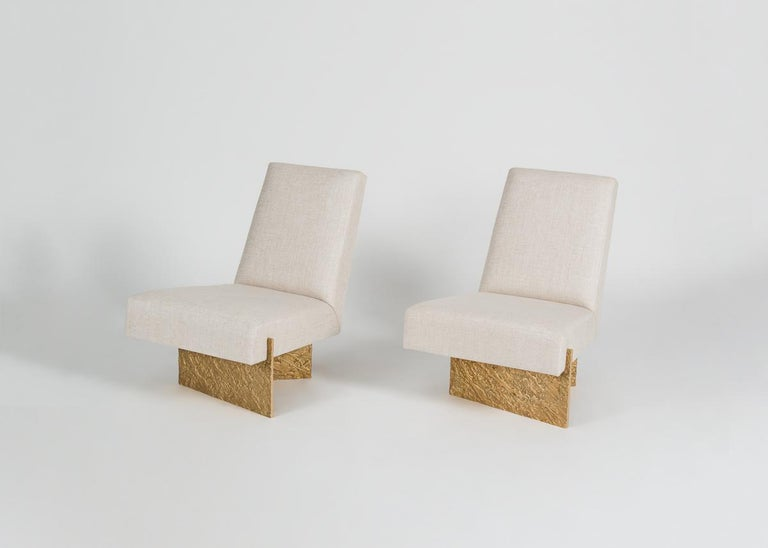 Limited edition of twenty.  With this wholly modern lounge chair, interior designer Thomas Pheasant evokes the elegance and delicacy of the Japanese art of paper folding. The base, made out of strong, solid cast bronze, possesses all the gentility