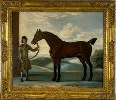 The racehorse 'Squirrel' held by a groom