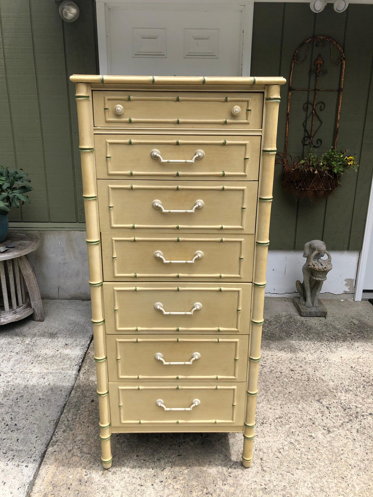 Thomasville Allegro faux bamboo lingerie chest. In the style of Henry Link. Gorgeous semanier in soft yellow with green accents. Solid metal pulls with gold and white wash. Classic designer piece with incredible detailing. This piece will never to