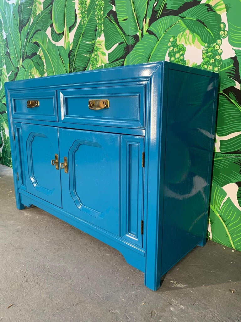 Thomasville buffet finished in high gloss blue. Original brass hardware. Very good vintage condition with minor imperfections to the newly lacquered finish.