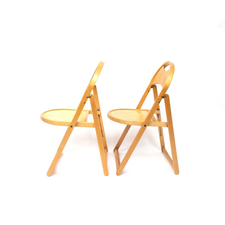 Tric is a redesign of Thonet's B-751 folding chair, that was first produced in 1925 and discontinued around late 1930s. Very functional and collectable. Classic Jugendstil. Production period 1970s. Beechwood folding chair. Quality check stamp on the