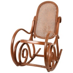 Thonet. A Vintage Bentwood Child's Rocking Chair with Cane Back and Seat, 1930s