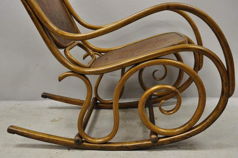 Austrian Thonet Bentwood Rocking Chair Figural Pressed Wood Griffins and Northwind Face For Sale