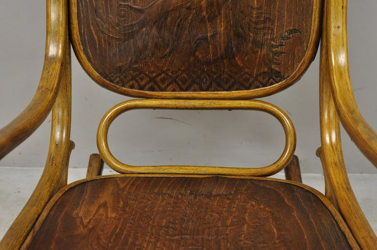Thonet Bentwood Rocking Chair Figural Pressed Wood Griffins and Northwind Face In Good Condition For Sale In Philadelphia, PA