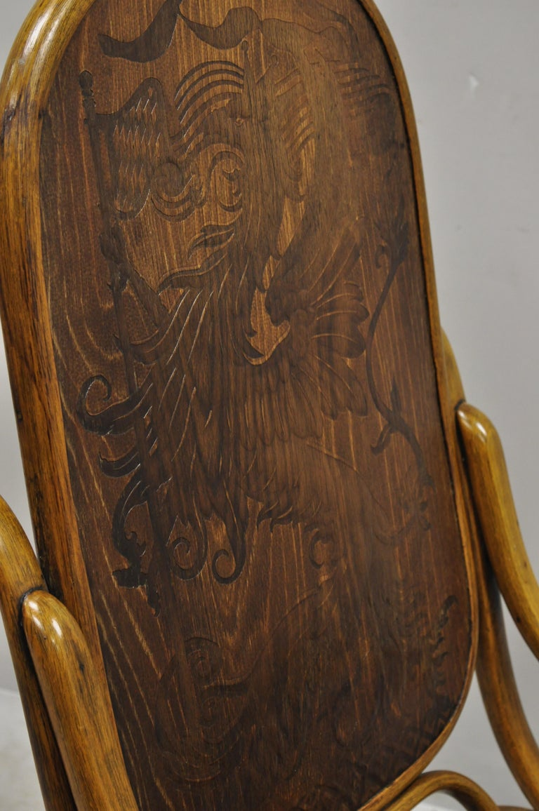 19th Century Thonet Bentwood Rocking Chair Figural Pressed Wood Griffins and Northwind Face For Sale