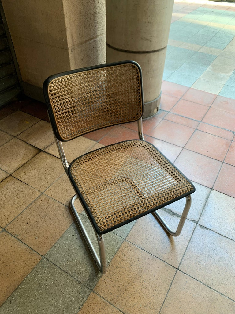 Chrome and reed cane The S32 armchair with reed cane was created by Marcel Breuer for the Thonet brand in the years 1928-1930. Dimensions: H80 x P59 x L46 cm  Seat height : 44 cm.