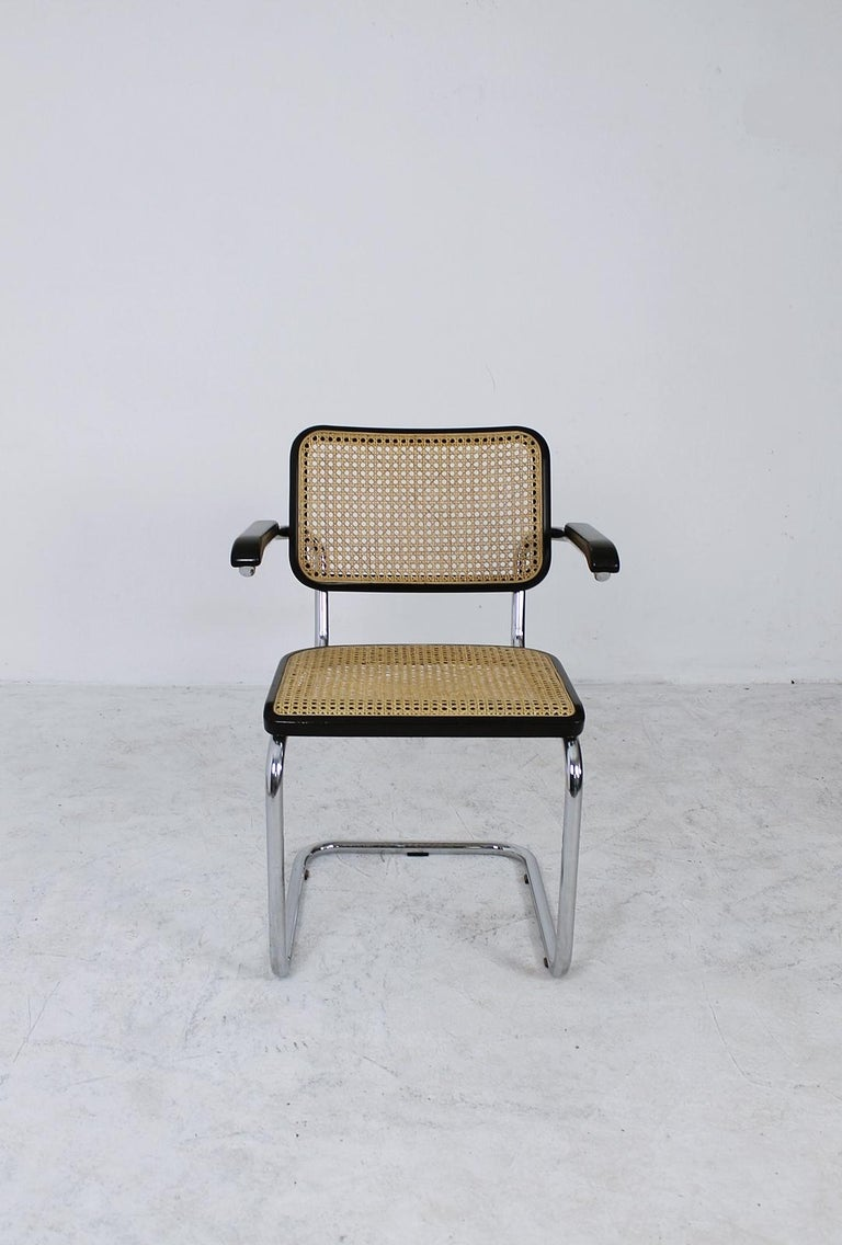 The B64 chair was designed by Marcel Breuer for Thonet in 1927. These original Thonet chair are made of chrome-plated tubular steel, dark stained beech, bentwood and cane. The first producer of the B64 was Thonet, starting in 1927. Later in the