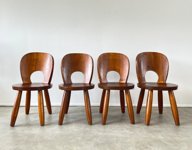 Incredible dining room chairs attributed to Thonet with fantastic shape and patina.  Douglas fir wood with chunky legs and solid construction -  Great from all angles - multiple available - priced individually.