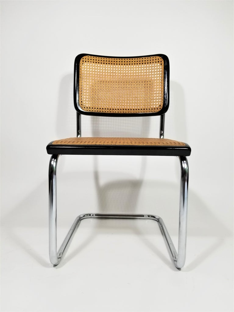 Authentic 1960s Mid Century Thonet Marcel Breuer Cesca Side Chair with Black Finish. Cane Seats and Backs. Classic Chrome Cantilever Frames.  Made by Thonet New York, NY. Still retains Original Marking Tag. Complimentary local NYC delivery can be