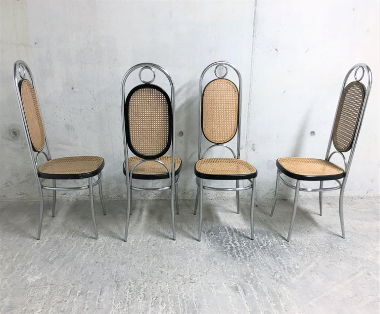 Set of 4 rare chrome Thonet no. 17 high back dining chairs.  These where porduced in Italy and one of the chairs still has a 'made in Italy' label.  The cane seats are in good condition.  1970s - Italy  Dimensions:  Measurements: