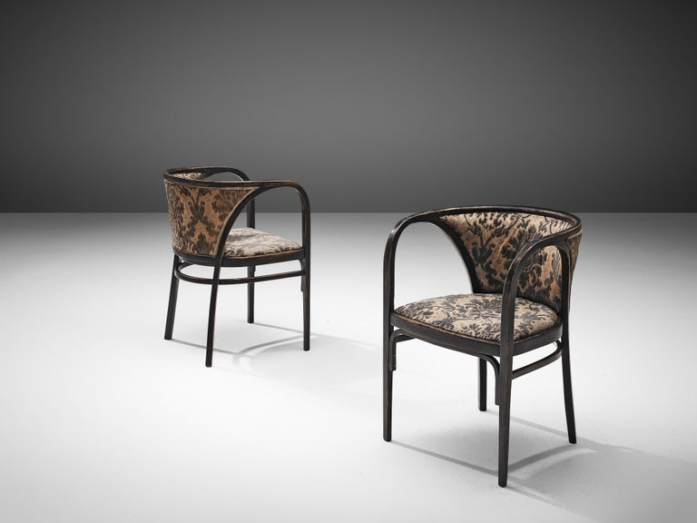 Pair of armchairs, attributed to Marcel Kammerer for Thonet, bentwood and fabric, Austria, ca. 1910  An elegant bentwood pair of armchairs consisting designed by Marcel Kammerer and manufactured by Thonet, Austria, circa 1910. The elegant pair is