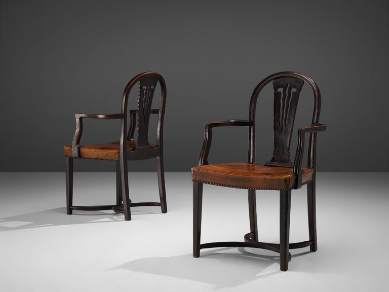 Thonet, pair of armchairs, wood, original patinated leather, brass, Austria, 1920s   A stunning pair of Art Deco armchairs by Thonet, produced in the 1920s. The chairs feature the architect-designed Viennese bentwood furniture in the Secession