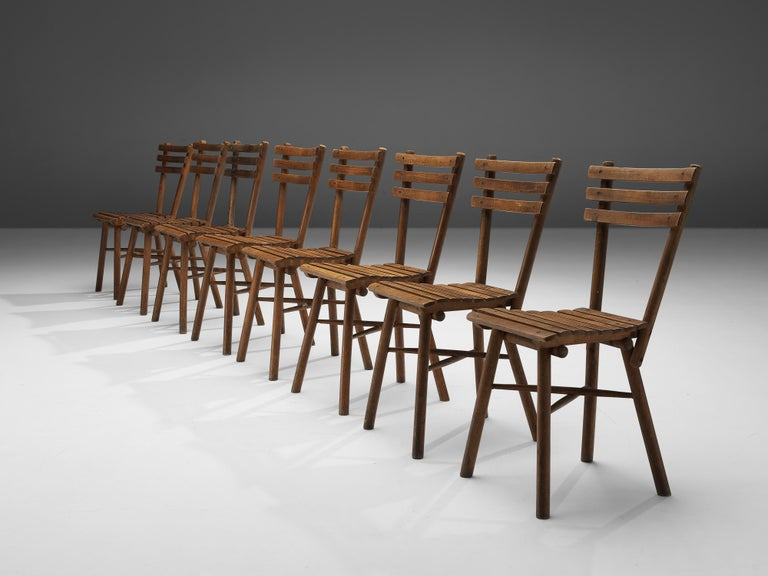 Thonet, side chairs, wood, Austria, 1950s  These for Thonet unusual chairs don't feature the usual bentwood. Instead, they are made of separate parts. Seat and backrest are not upholstered but have a rhythmic construction of parallel wood slats.