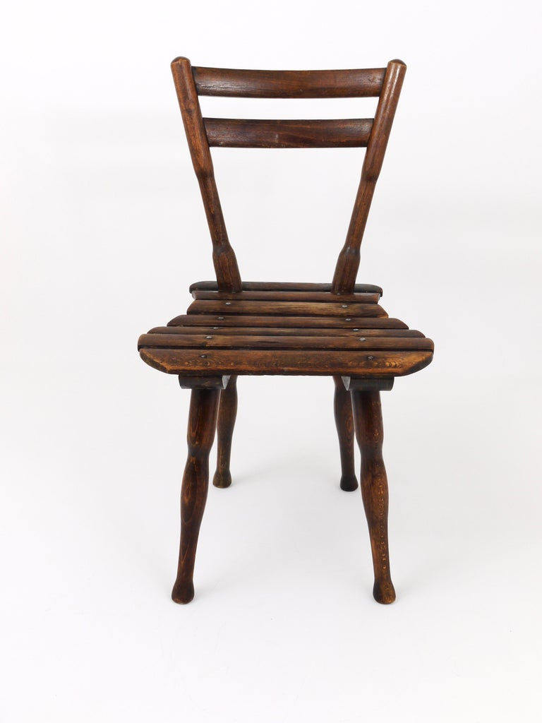 A lovely wooden chair for children by Thonet Vienna, dated around 1900. In good, original condition with nice patina. Labelled and stamped.