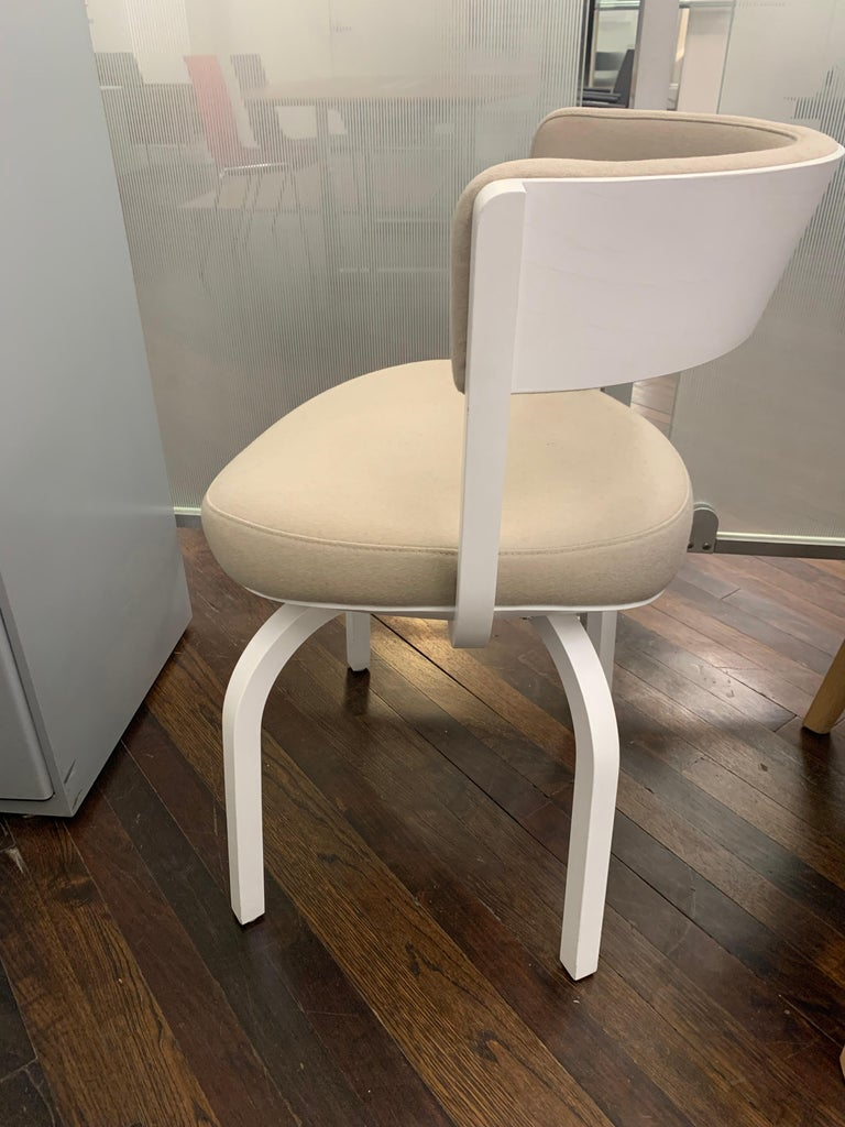 Elegantly curved wooden elements and striking upholstery offers comfort. Upholstered Thonet 405 PF chair Beech White pigmented lacquer frame Fabric: Kvadrat divina 224 Plastic glides.