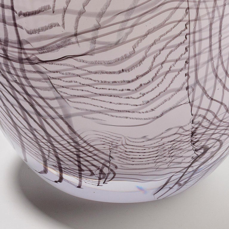 Hand blown white glass with grey thread-glass. Engraved top, grey thread-glass applied free handed while hot. Made in Amsterdam, the Netherlands.