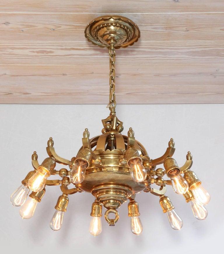Thorvald Bindesbøll (1846 Copenhagen, Denmark 1908), twelve-armed 'Sun' chandelier, circa 1900, designed in the Skønvirke (arts + crafts) style, brass, large size.  Manufactured by F. W. Doberck and Søns Eftf. v. C. Amundin. H. A/S, Copenhagen,