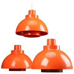 Three 1960s Danish Orange Model Minisol Pendant Lights by Svend Middelboe
