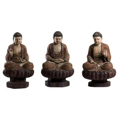 Three Ancient Wooden Buddha Sculptures