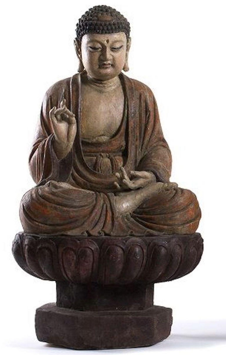 Three ancient wooden Buddha sculptures is an original beautiful and fine manufacture realized in China.   Original painted and lacquered wood.   Provenance: Private Collection.  Each sculpture is 100 cm high.  The three deities are in