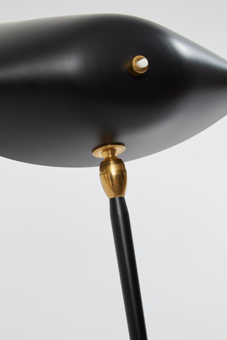 "Three-arm floor lamp by Serge Mouille. Originally designed by Serge Mouille in 1952. This light is a licensed re-edition from the ""Black Shapes"" series currently manufactured by Editions Serge Mouille in France. Steel and painted black base, with"