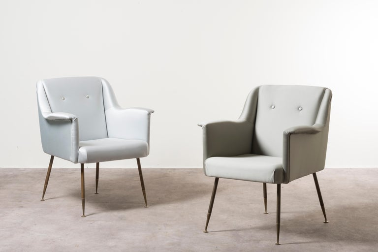 Three armchairs mod. Camelia by Carlo Pagani. Italy, 1951. Manufactured by Arflex. Brass, fabric upholstery. Measures: 77 x 57 x H 85 cm. 30.3 x 22.4 x 33.5 in. Please note: Prices do not include VAT. VAT may be applied depending on the ship-to