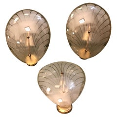 Three Art Deco Brass and Glass Italian Shell Wall Sconces, circa 1930