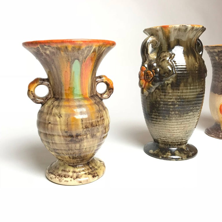 Three unique Art Deco handmade glazed vases from the famous pottery region Thuringia. Thuringia is the home of the most renowned ceramic manufactories in Germany. Very decorative vases with powerful colors.  Year of production: