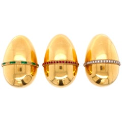Three Big Golden Eggs with Diamonds Emeralds and Rubies in 18K yellow gold