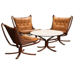 Three Camel Leather 'Falcon' Lounge Chairs and Coffee Table by Sigurd Ressell