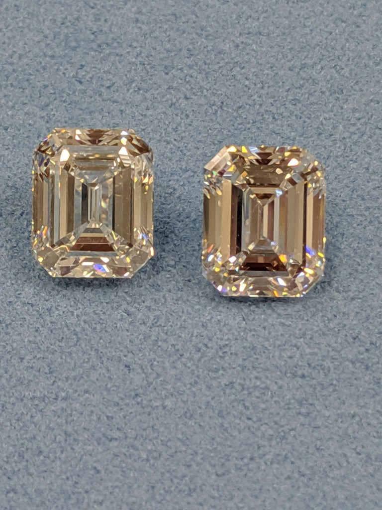 A more perfectly matched pair of Six total carats (Three carats each)  colorless Emerald Cut diamonds does not exist in the marketplace today.  This pair GIA graded F color VVS2 clarity Emerald Cut Diamonds  is ready for the perfect design