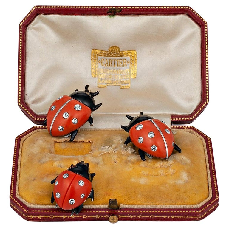 Ladybugs symbolize luck and, in this case, three times the karma.  With a trio of rare Cartier London and Paris diamond coral enamel and gold ladybug brooches on your lapel, you will have hit the lottery.  The two larger ladybugs are approximately 1