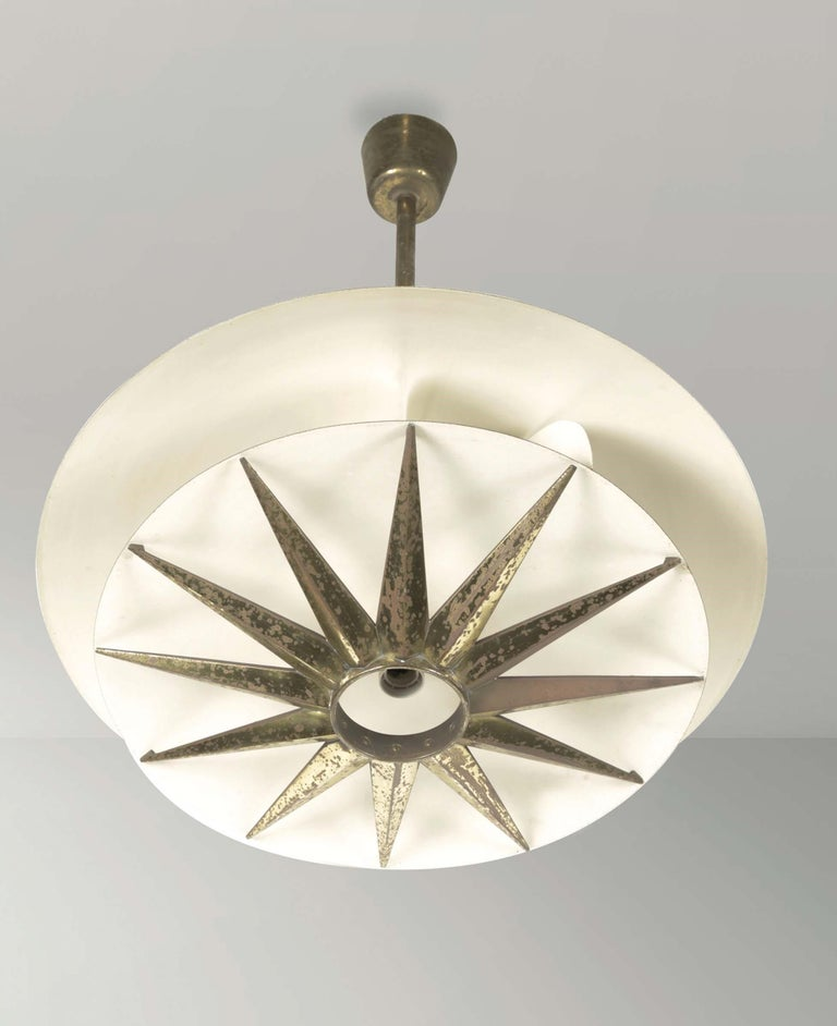 Three chandeliers with brass and metal structure, Tommaso Buzzi by Donzelli.
