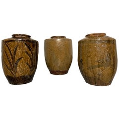 Three Chinese Olive and Brown Glazed Storage Jars, Late 19th Century