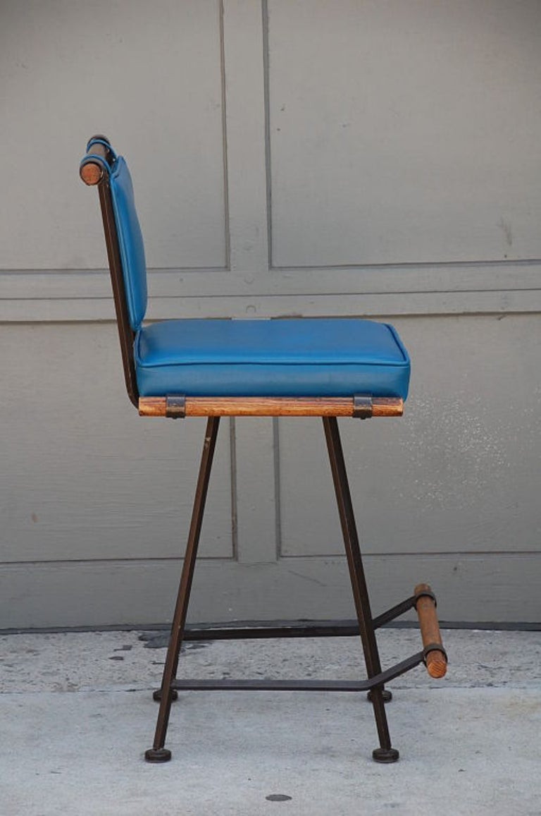 Painted Three Comfortable Wrought Iron and Oak Swiveling Counter Stools by Cleo Baldon For Sale