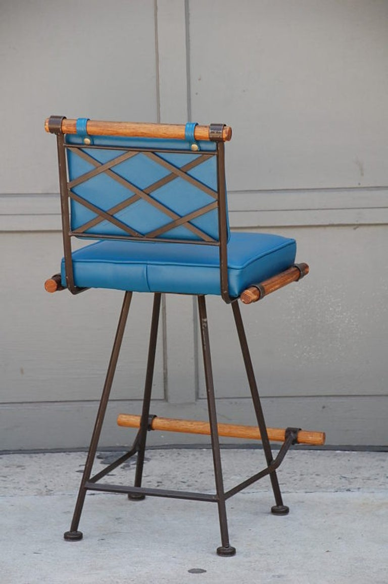 Three Comfortable Wrought Iron and Oak Swiveling Counter Stools by Cleo Baldon In Good Condition For Sale In Los Angeles, CA