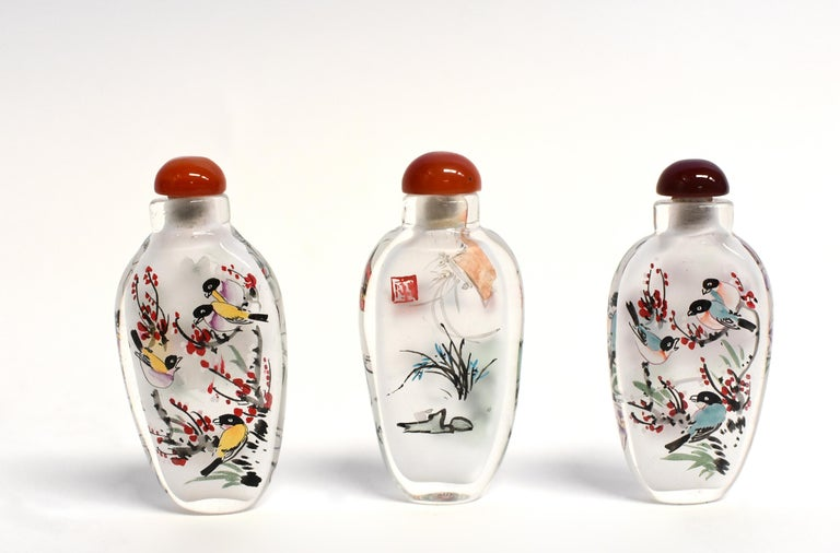 Chinese Three Églomisé Reverse Painted Snuff Bottles with Magnolia and Orchid For Sale