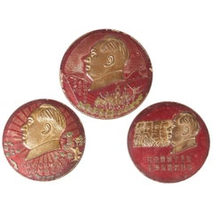 Three Embossed Metal Cultural Revolution Plaques with Images of Mao