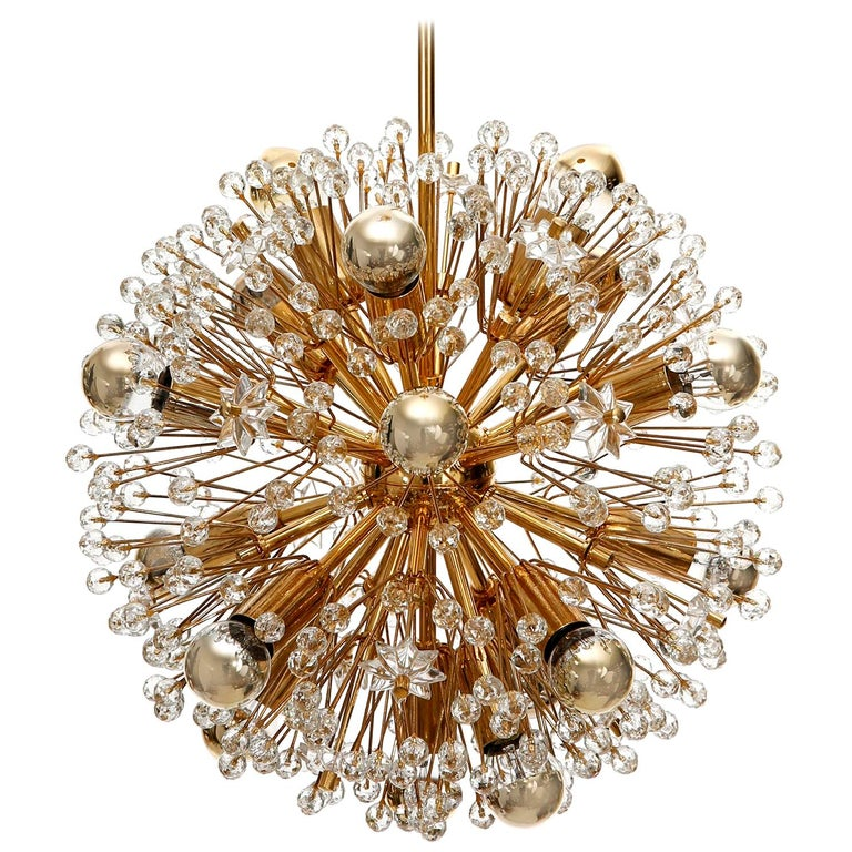 One of three Sputnik chandeliers designed by Emil Stejnar and manufactured in midcentury, circa 1970. This beautiful light fixture is made of a 24-carat gold-plated brass frame which is decorated with cut glass in the form of beads and stars. This