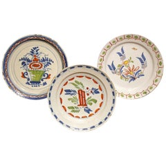 Three English Delftware Decorative Plates with Polychrome Colors