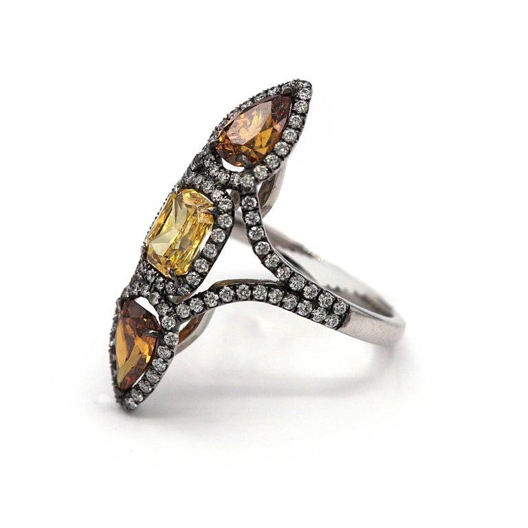 Modern Three Fancy Color Diamonds Ring 3.49 Carat Total Vivid Yellow Deep Orange-Yellow For Sale
