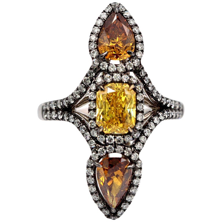 Three Fancy Color Diamonds Ring 3.49 Carat Total Vivid Yellow Deep Orange-Yellow For Sale