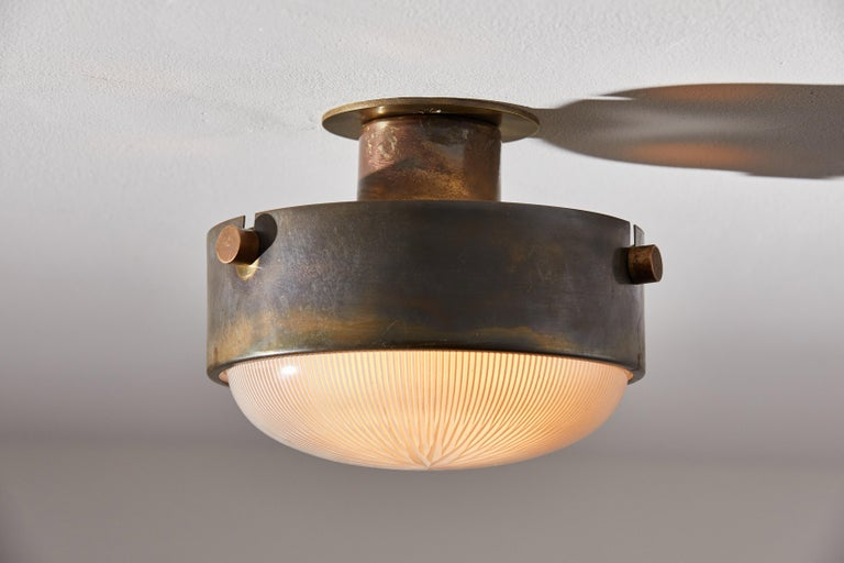 Three flush mount ceiling lights by Ignazio Gardella. Designed and manufactured in Italy, circa 1950s. Brass, Holophane glass. Rewired for U.S. junction boxes. Each light takes one E26 Edison 75w maximum bulb. Bulbs provided as a one time courtesy.
