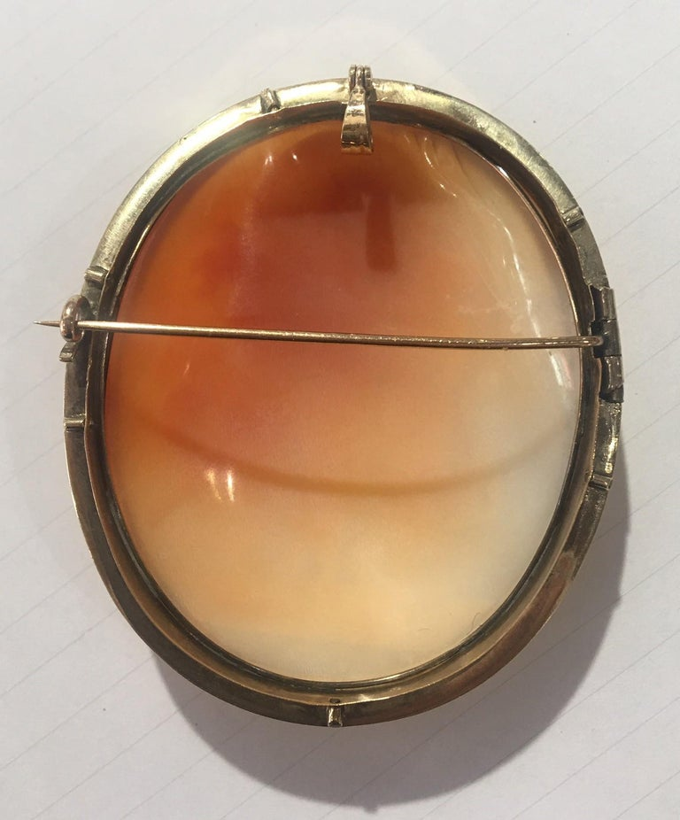 Elegant and Stylish Antique Cameo Brooch Pendant depicting The Three Graces; Beautifully Hand Carved in High Relief Estate piece; Meticulously artisan engraved with exquisite detail, this romantic natural carnelian shell cameo is set in a Beautiful