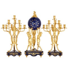 'Three Graces,' Three-Piece Lapis and Gilt Bronze Clock Set